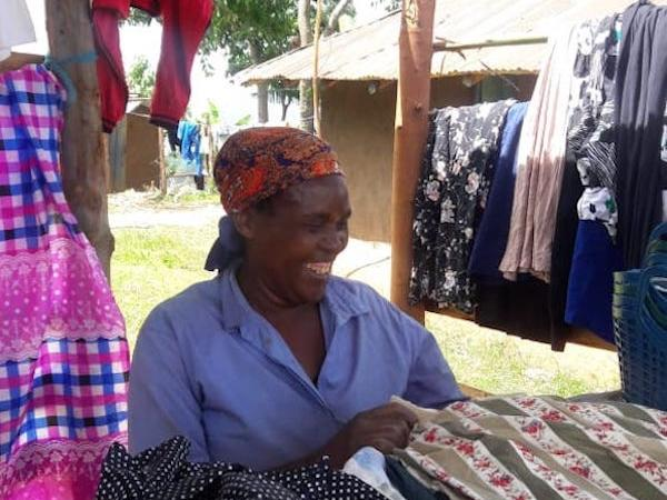 Mary Ondisa smiling at her clothing stall