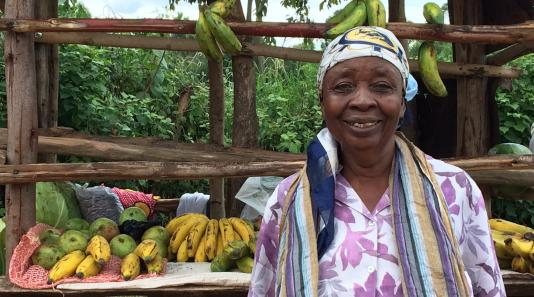 Woman at her fruit stand in Kenya