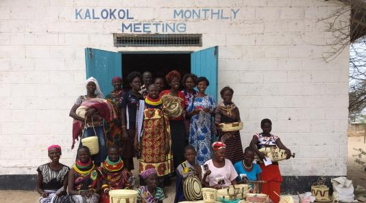 Women in front of Kalokol Monthly Meeting in Turkana, Kenya