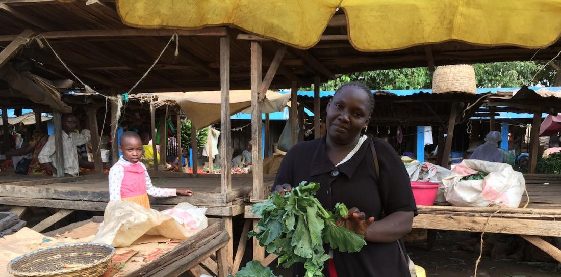 A member of JFWG selling vegetables in the market.