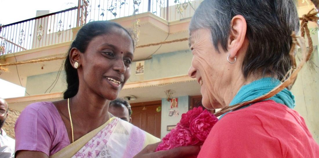 Mrs. Jayanthi, the Managing Trustee of Women's Voice Trust, in Chinnamanur, Theni District, welcoming RSWR Board member Marian Beane to their brick-making project.
